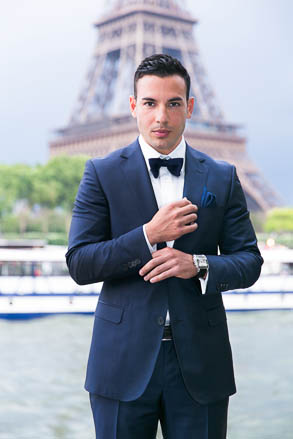 Groom adjusting Cuffs in Front of Eiffel Tower