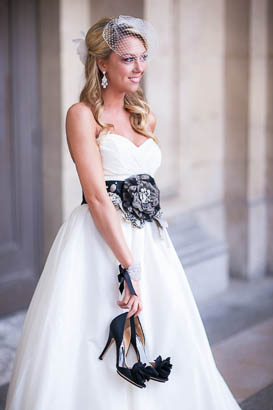 Smiling Bride Holding Wedding Shoes