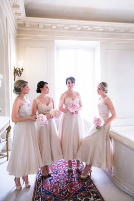 Bridesmaids Holding Bouquets In Marbled Hall of French Chateau